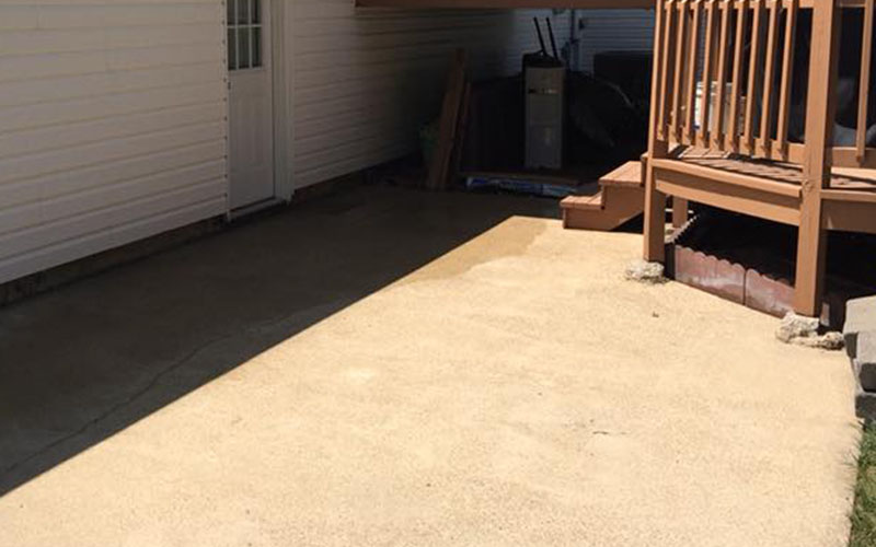 Just Clean Pressure Washing provides quality concrete porch cleaning